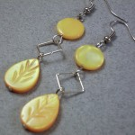 Flat coin orange mop leaf earrings